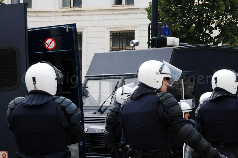 Riot police in full gear deploying.