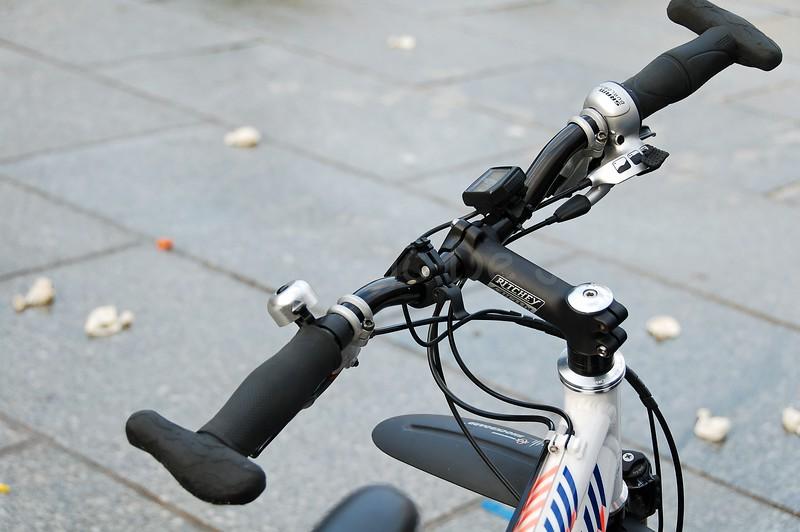 The handle-bar of a mountain bike (MTB) of a Dutch police bike team.