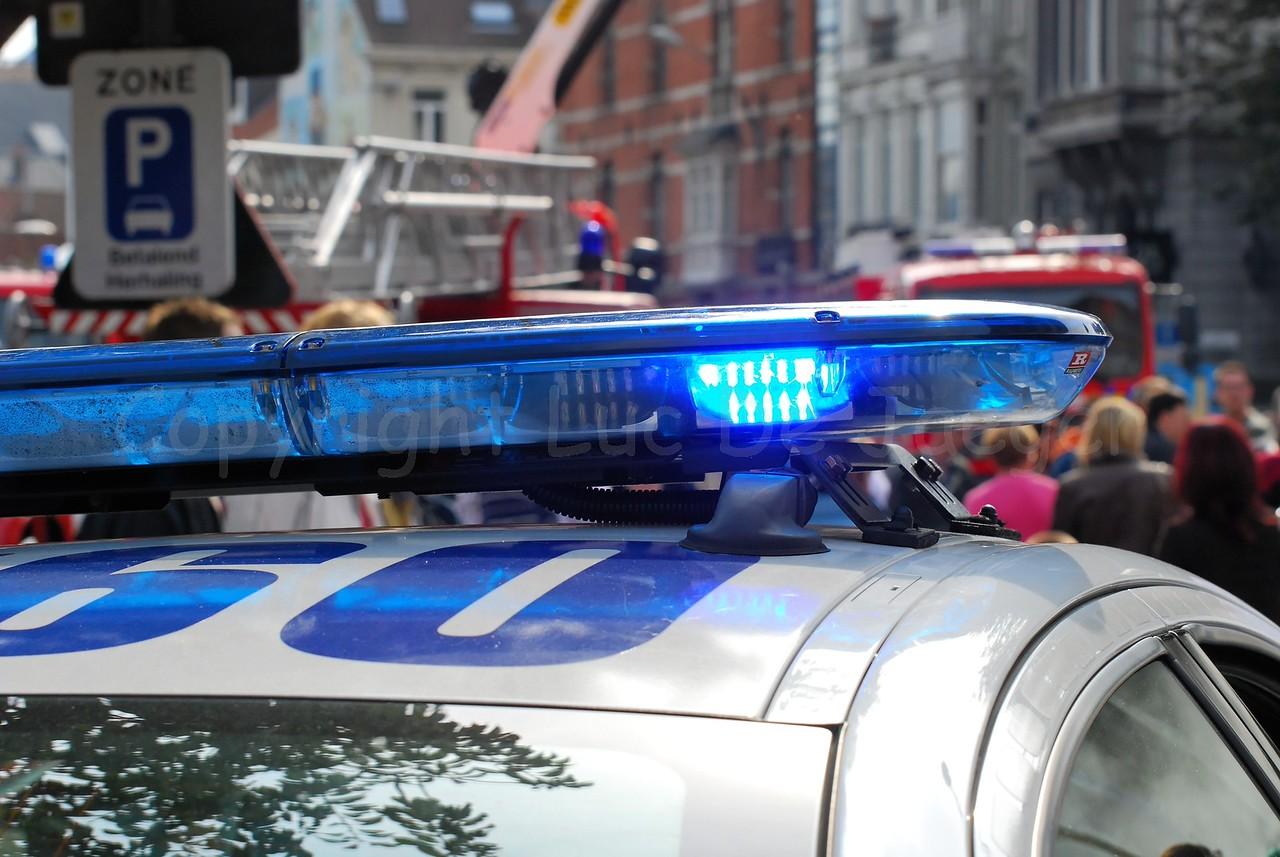 The blue flashing light of a Dutch police car.