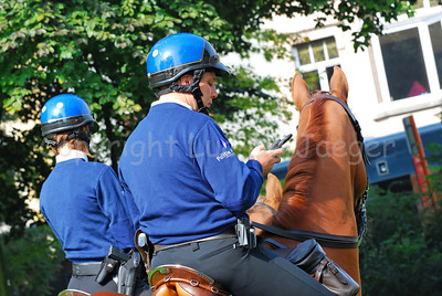A team of the Belgian federal mounted police ready to patrol and receiving instructions through his portable digital radio.