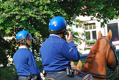 A team of the Belgian federal mounted police ready to patrol and receiving instructions through his portable radio.