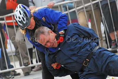The arrest of a suspect by a police bike team. The suspect is handcuffed.