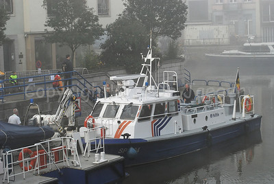A patrol boat of the Belgian Federal Police in the mist/fog.