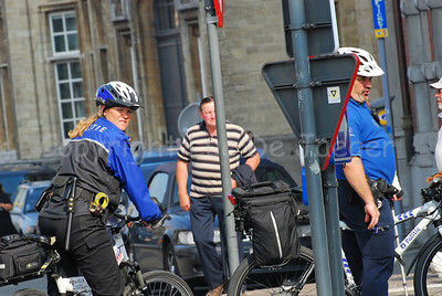 A police woman of the bike team of the police of Maastricht, the Netherlands (left) and her colleague of the bike team of the police of Ghent (Gent), Belgium (right) in the streets of Ghent.