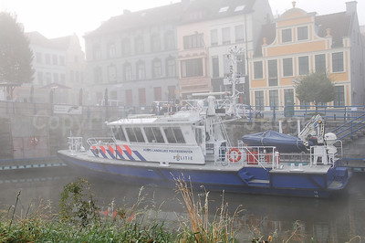 A police boat from the Dutch National Police Services Agency (Korps Landelijke Politiediensten KLPD) in the mist/fog.