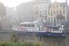 A police boat from the Dutch National Police Services Agency (Korps Landelijke Politiediensten KLPD) in the mist/fog.