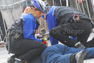 The arrest of a suspect by a police bike team of Maastricht, the Netherlands. The suspect is being handcuffed.