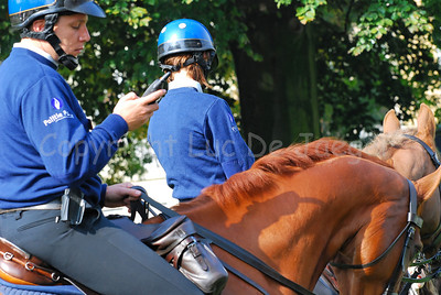 A team of the Belgian federal mounted police ready to patrol and receiving instructions through the portable digital radio.
