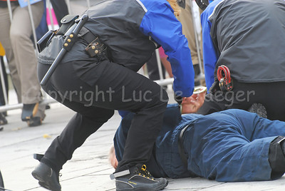 The arrest of a suspect by a police bike team. The suspect is being handcuffed.
