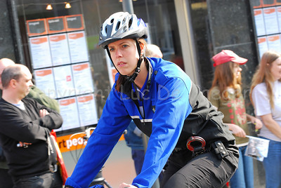 A police woman of the bike team of the police of Maastricht, the Netherlands, cycling through the streets of Ghent (Gent), Belgium.