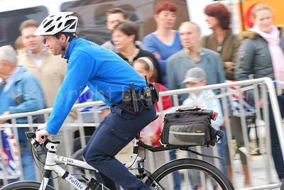 A police officer of the bike team of the local police of Ghent (Gent), Belgium, cycling.