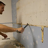 Record-Eagle/Douglas Tesner<br /> John Kose cleans old paint off a bathroom wall at Mt. Holiday.
