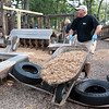 Record-Eagle/Douglas Tesner<br /> Peter Semeyn moves a load of wood chips for the Kids Cove at the Grand Traverse Civic Center.