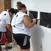 Gary Church/NEWS<br /> <br /> Laurel students Evan Armagost, 11th grade, and Alicyn Ferrante, 10th grade, paint a garage door at the L.C.A.R.C. home.