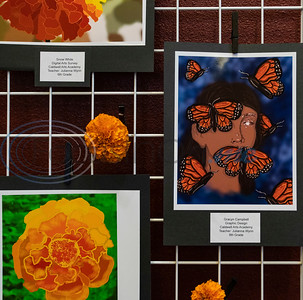 Digital artwork of marigold flowers and butterflies by Caldwell Arts Academy students are on display during the school's Day of the Dead celebration held inside Caldwell Auditorium on Monday, Nov. 2, 2020.