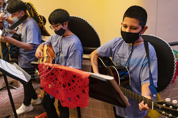 Caldwell Arts Academy seventh graders Adrian Castillo and Luis Moreno play in the school mariachi band during the school's Day of the Dead celebration held inside Caldwell Auditorium on Monday, Nov. 2, 2020.