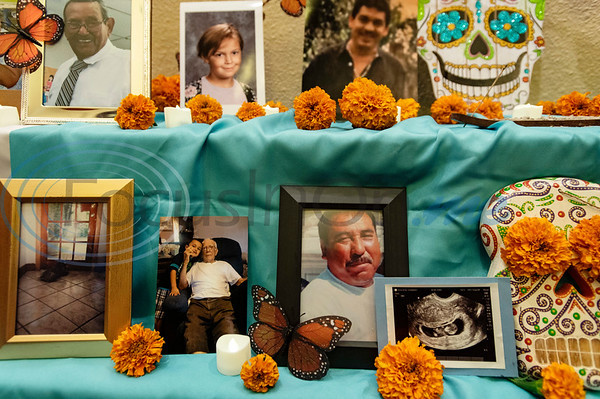 Caldwell Arts Academy students and families contributed photos of loved ones who have died to form an alter at the school's Day of the Dead celebration held inside Caldwell Auditorium on Monday, Nov. 2, 2020.