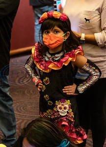 Caldwell Arts Academy kindergartener Mia Moreno, 6, dressed up with flowers and a skeleton dress for the school's Day of the Dead celebration held inside Caldwell Auditorium on Monday, Nov. 2, 2020.