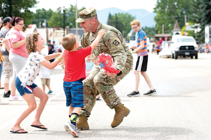 Matthew Gaston | The Sheridan Press<br>Seven-year-old Natalee Weiser and her little brother Henry, 4, run out to hug their father, Captn. George Weiser during the Dayton Days Parade Saturday, Jully 27, 2019.
