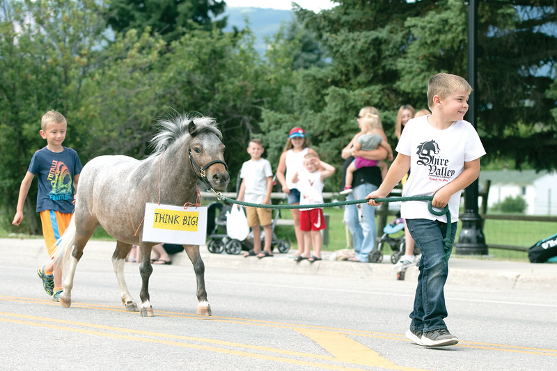 "Matthew Gaston | The Sheridan Press<br>A boy and his pony encourage the crowd to ""Think big!"" during the Dayton Days Parade Saturday, July 27, 2019."