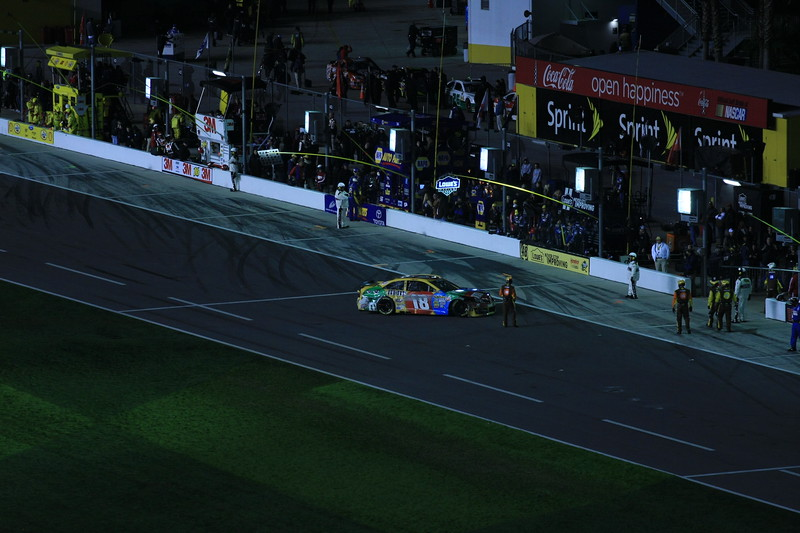 M & M Car number 18 leaving the field after the wreck....