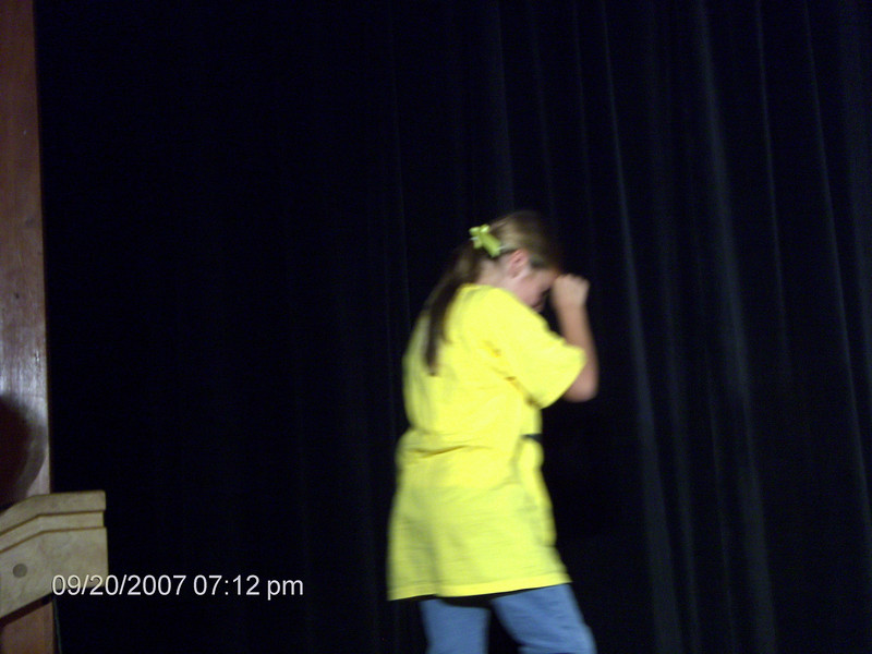Delaney going up on the stage w/her classmates...she was shy.