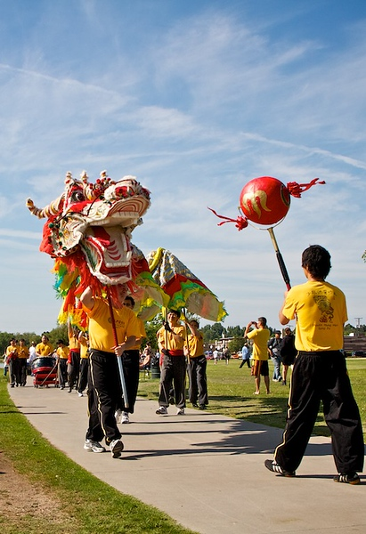 The dragon is trying to catch the red ball