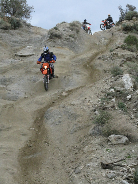 Another rider going down the Pinyon Drop Off.