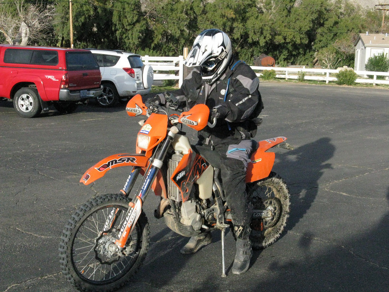 Another rider rolls in after a long day of riding.