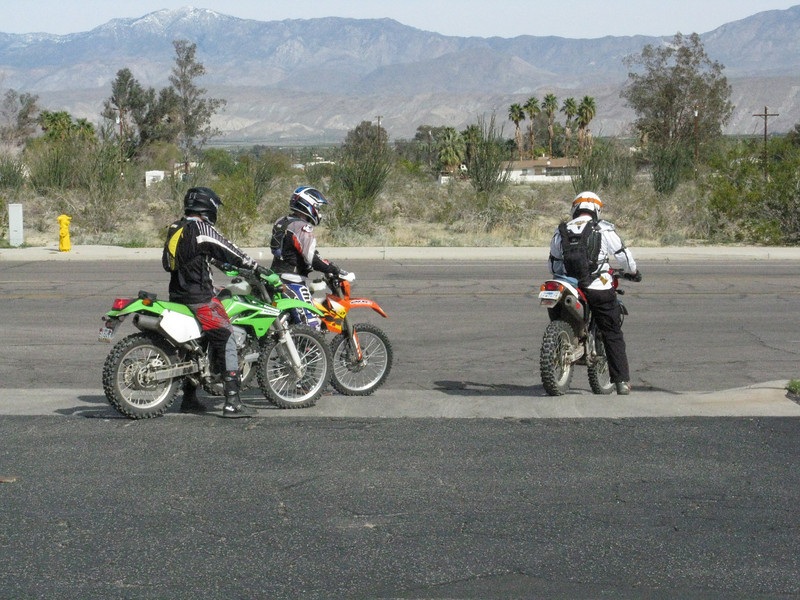 Three more riders take off from the gas station for the next stage.