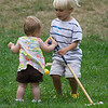 Liam tutoring Eve on the finer points of Croquet
