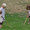 Liam and Grace giving Eve a hand with Croquet