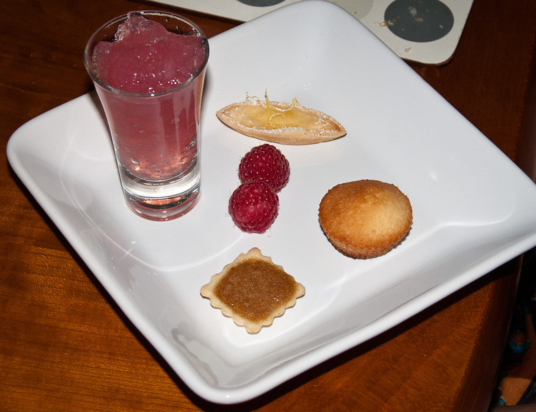 Les Petites Fours<br /> Pink champagne jelly shot, Mini lemon boat, Mini treacle tart, Lemon cake bites, Raspberries<br /> Bolivian Machcamarca 2010