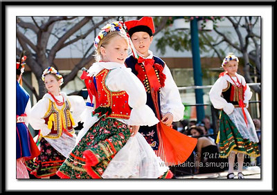 Young children perform traditional Polish folk dance.