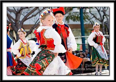 Young children perform traditional Polish folk dance.