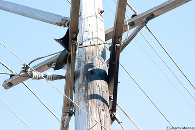Note the now-missing section of ground wire running down the pole.