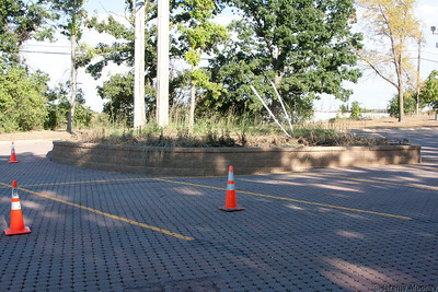 Pole base/burned brush. Cones to keep spaces clear for repair trucks.