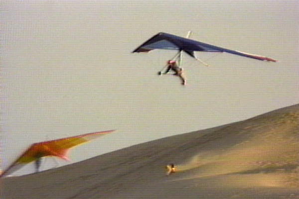 "Hang Gliding in Torrey Pines California and Kitty Hawk North Carolina from the ""Stone's Throw"" series by Ben Stone and Doug Gilchrist."
