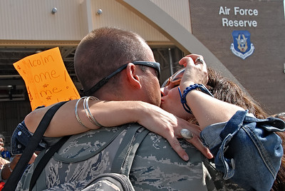 09-21-12  --dobbins homecoming 09--  Lizette Prater of Powder Springs gives her husband Staff Sgt. Matthew Prater a kiss as he arrives at Dobbins Air Reserve Base in Marietta on Friday morning after a four month deployment to the Middle East.  STAFF/LAURA MOON.