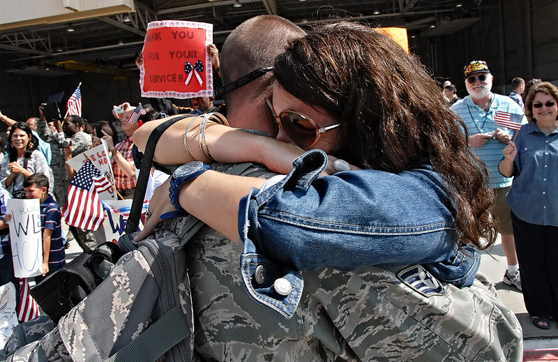09-21-12  --dobbins homecoming 08--  Lizette Prater of Powder Springs hugs her husband Staff Sgt. Matthew Prater tightly as he arrives at Dobbins Air Reserve Base in Marietta on Friday morning after a four month deployment to the Middle East.  STAFF/LAURA MOON.