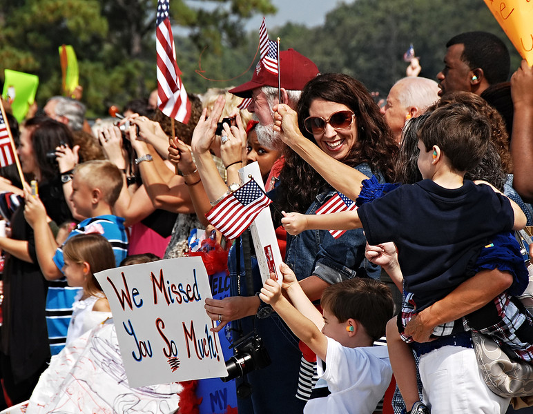 09-21-12  --dobbins homecoming 01--  Lizette Prater of Powder Springs and her sons Luke, in white, and Wes, in blue get excited as the C-130 arrives at Dobbins Air Reserve Base in Marietta with her husband Staff Sgt. Matthew Prater who has been serving in the Middle East for the past four months.  STAFF/LAURA MOON.