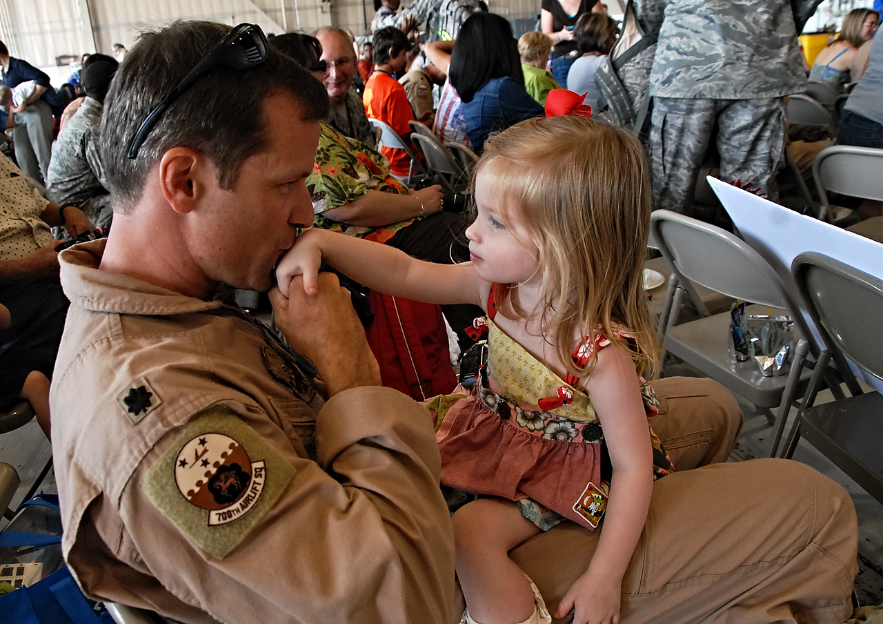 09-21-12  --dobbins homecoming 12--  Lt. Col. Brian Ferguson of Marietta plays with his two-and-a-half-year-old daughter Allie at Dobbins Air Reserve Base on Friday morning as he returns from serving in the Middle East.  STAFF/LAURA MOON.