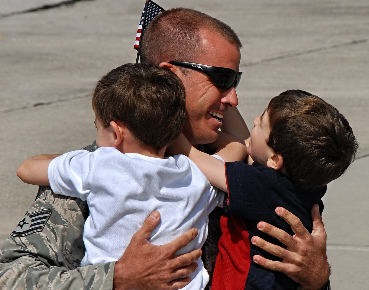 09-21-12  --dobbins homecoming 06--  Staff Sgt. Matthew Prater of Powder Springs gives his son Wes, 3, a big smile and hug as his other son Luke, 5, wraps his arms around his father.  STAFF/LAURA MOON.