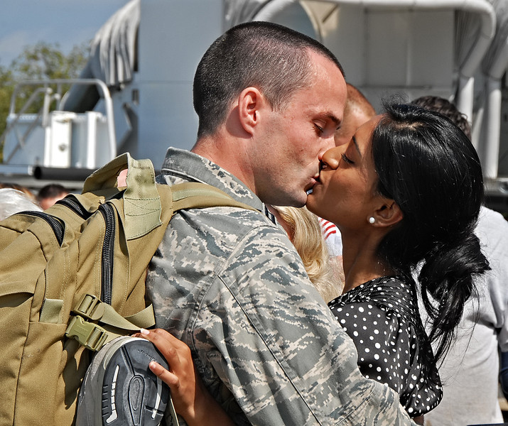 09-21-12  --dobbins homecoming 11--  Capt. Brian Fessler of Atlanta gives his girlfriend Shehzin Jafar of Atlanta a kiss as he arrives home from his third military tour.  STAFF/LAURA MOON.