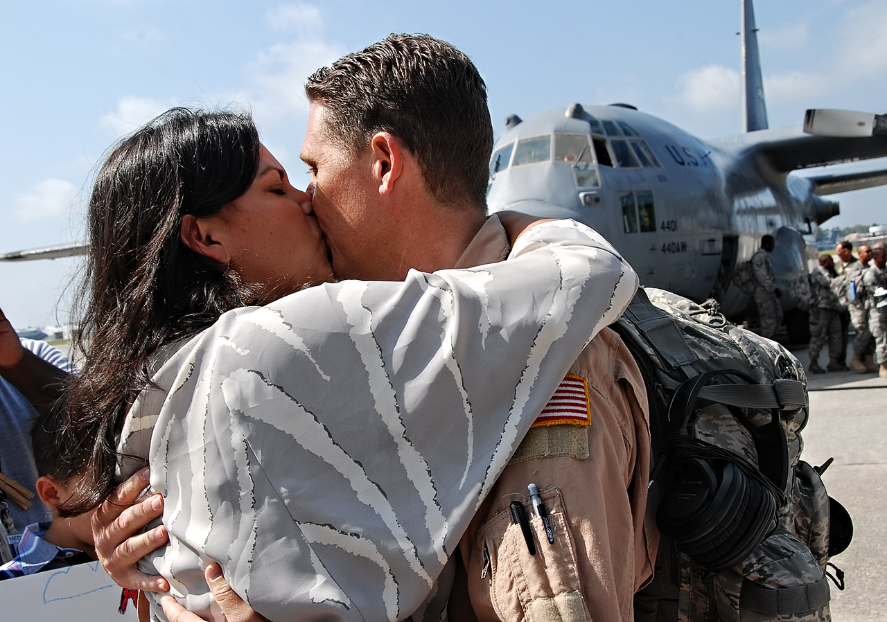 09-21-12  --dobbins homecoming 05--  Teresa Gohlke of Powder Springs gives her husband Lt. Col. Chris Gohlke a welcome home kiss on Friday morning.  STAFF/LAURA MOON.