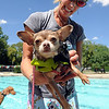 "Oakley Gardner has her dog Olive ready for the swim.<br /> The first day of the annual Dog Dayz at Scott Carpenter Pool was held on Wednesday. For more photos and a video of the dogs, go to  <a href=""http://www.dailycamera.com"">http://www.dailycamera.com</a>.<br /> Cliff Grassmick / August 18, 2010"