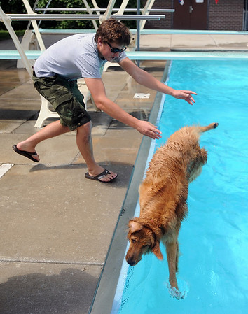 "Mat Barlow helps his dog get into the water.<br /> The first day of the annual Dog Dayz at Scott Carpenter Pool was held on Wednesday. For more photos and a video of the dogs, go to  <a href=""http://www.dailycamera.com"">http://www.dailycamera.com</a>.<br /> Cliff Grassmick / August 18, 2010"