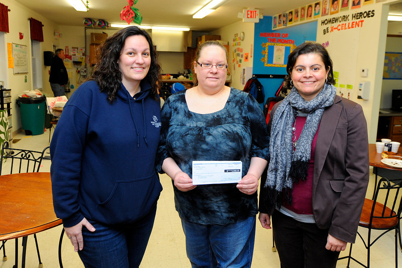 Lisa Boivin (center), manager of the 99 Restaurant in Fitchburg, holds a $5,938 check on Wednesday where funds were raised in the month in October during a fundraiser held for the Boys & Girls Clubs. A total of $6,104 was raised. Michelle Belleza, executive director of the Lunenburg Boys & Girls Club (left), will receive $1,000 for the club and representing the Leominster & Fitchburg Boys & Girls Club, Patty Fields (right), resource development director, will receive the remainder for the club.<br /> SENTINEL & ENTERPRISE / BRETT CRAWFORD