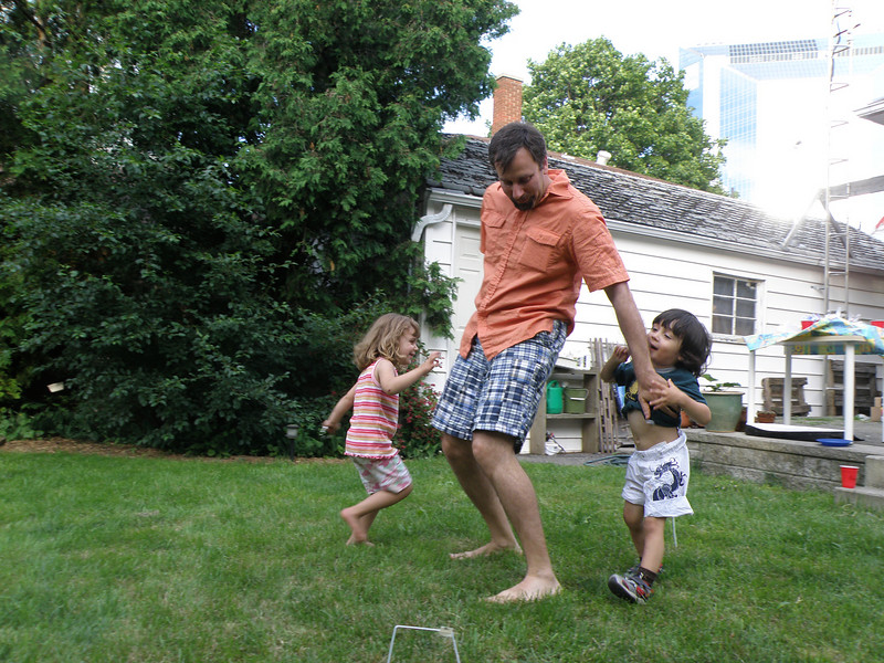 """Paul Hirst with daughter Rebecca, and Evan Taniguchi. """"Ring around the Daddy!"""""""