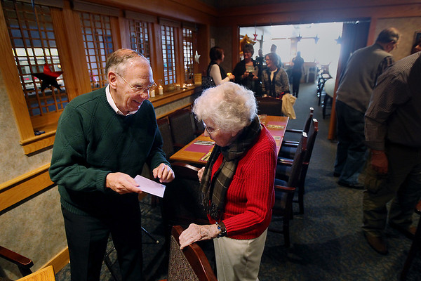 "Record-Eagle/Keith King<br /> Bob Witkop hands a birthday card to Doris Brackett, of Traverse City, Saturday, January 21, 2012 during Brackett's birthday celebration lunch at the Traverse City Elks Lodge which was attended by family members and close friends. ""Happy Birthday boss,"" Witkop said. Witkop first met Brackett in the late fifties, when he started referring to her as ""boss,"" while he was living with her and her husband, Arthur, when Witkop attended Northwestern Michigan College. Brackett also worked for Witkop as an accountant. Brackett turned 108-years-old on Friday, January 20. She was born on January 20, 1904 in Monroe County, Michigan. She is a huge fan of the Detroit Red Wings and Detroit Tigers and enjoys crossword puzzles. Brackett worked in accounting for a bit and volunteered at the Traverse City Convention and Visitors Bureau until she was 100. ""She's still a whiz with numbers; she won't use a calculator,"" Chuck Ellibee, Brackett's grandson-in-law, said. When the Detroit Red Wings play a game on the west coast, Brackett will take a nap so that she's able to stay up later and watch the game.  Brackett attributes her longevity to ""being around good people and having good friends."""